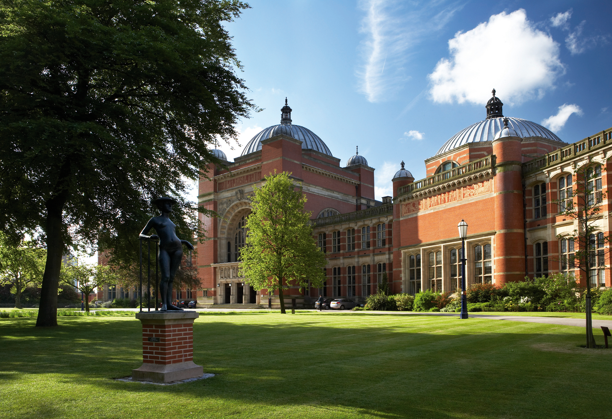 Picture of red-brick buildings and grass on The University of Birmingham campus