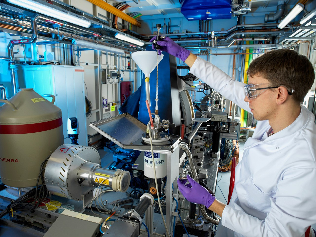 Researcher loading sample onto beamline
