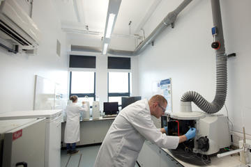 Scientists in analytical radiochemistry laboratory